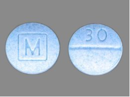 Front and back of counterfeit Percocet pills containing fentanyl