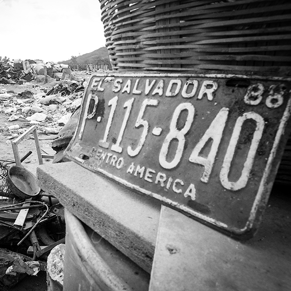 Image of a license plate from El Salvador at a landfill