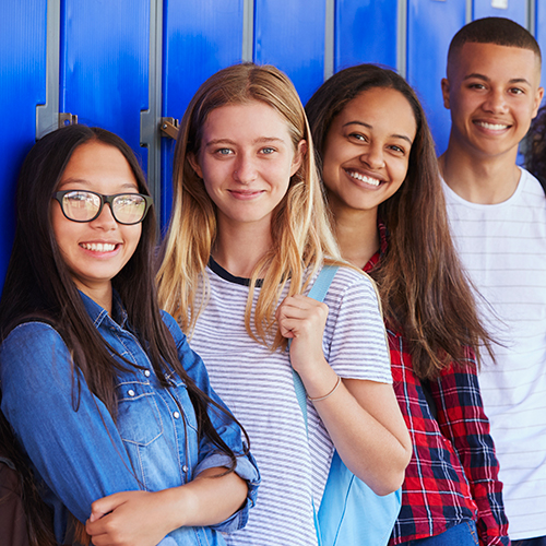 Photo of students in front of lockers